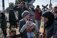 A woman holding her child is seen in the Idomeni refugees camp near by the Greek Macedonian border. Idonemi, Greece. FEDERICO SCOPPA/CAPTA