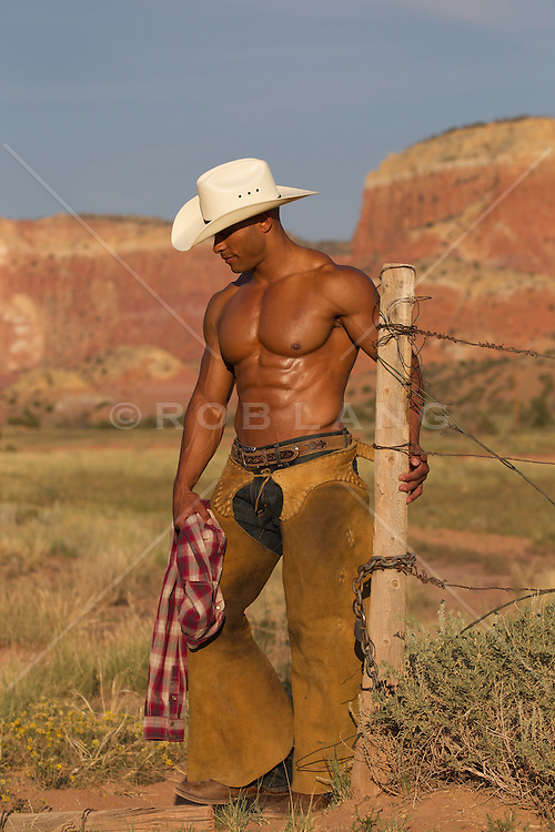 shirtless African American cowboy with great abs and chest outdoors in New Mexico