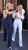 Khloe Kardashian and Kylie Jenner leave a downtown hotel