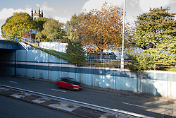 © Licensed to London News Pictures. 27/10/2019. Salford, UK. A car lies on its side on a pedestrian walkway at the Pendleton Roundabout on Broad Street in Salford . Members of the public pulled a man and a woman from the wreckage after a BMW car crashed through a barrier and landed on a pedestrian walkway below . Their condition is unknown and police , paramedics and fire crews are at the scene . Photo credit: Joel Goodman/LNP