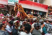 People carrying a deity on their way towards the Dhalpur ground, Kullu. Kullu Dussehra is the Dussehra festival observed in the month of October in Himachal Pradesh state in northern India. It is celebrated in the Dhalpur maidan in the Kullu valley. Dussehra at Kullu commences on the tenth day of the rising moon, i.e. on 'Vijay Dashmi' day itself and continues for seven days. Its history dates back to the 17th century when local King Jagat Singh installed an idol of Raghunath on his throne as a mark of penance. After this, god Raghunath was declared as the ruling deity of the Valley.