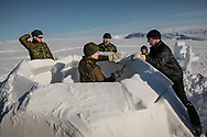 Canadian soldiers train to build an igloo.<br /> A small 2 persons igloo could take two hours to complete by experienced Inuit. 16 April 2012.