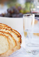 Loaf of Bread and Glass of Water on table close up