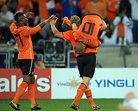 Durban World Cup 2010  Holland v Slovakia Match 53 28/06/10<br /> Wesley Sneijder (Holland) celebrates second goal with Dirk Kuyt  and eljero Elia<br /> Photo Roger Parker Fotosports International