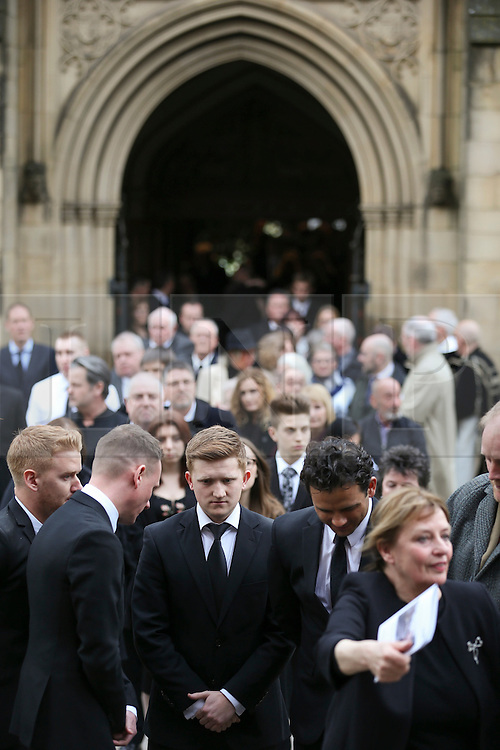© Licensed to London News Pictures . 18/03/2016 . Manchester , UK . Guests and actors leave the service. Television stars and members of the public attend the funeral of Coronation Street creator Tony Warren at Manchester Cathedral . Photo credit : Joel Goodman/LNP