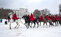 © Licensed to London News Pictures. 01/03/2018. London, UK. The Queen's Life Guard of the Household Cavalry Mounted Regiment cross a snowy Horse Guards Parade in central London. The 'Beast from the East' and Storm Emma have brought extreme cold and heavy snow to the UK. Photo credit: Peter Macdiarmid/LNP