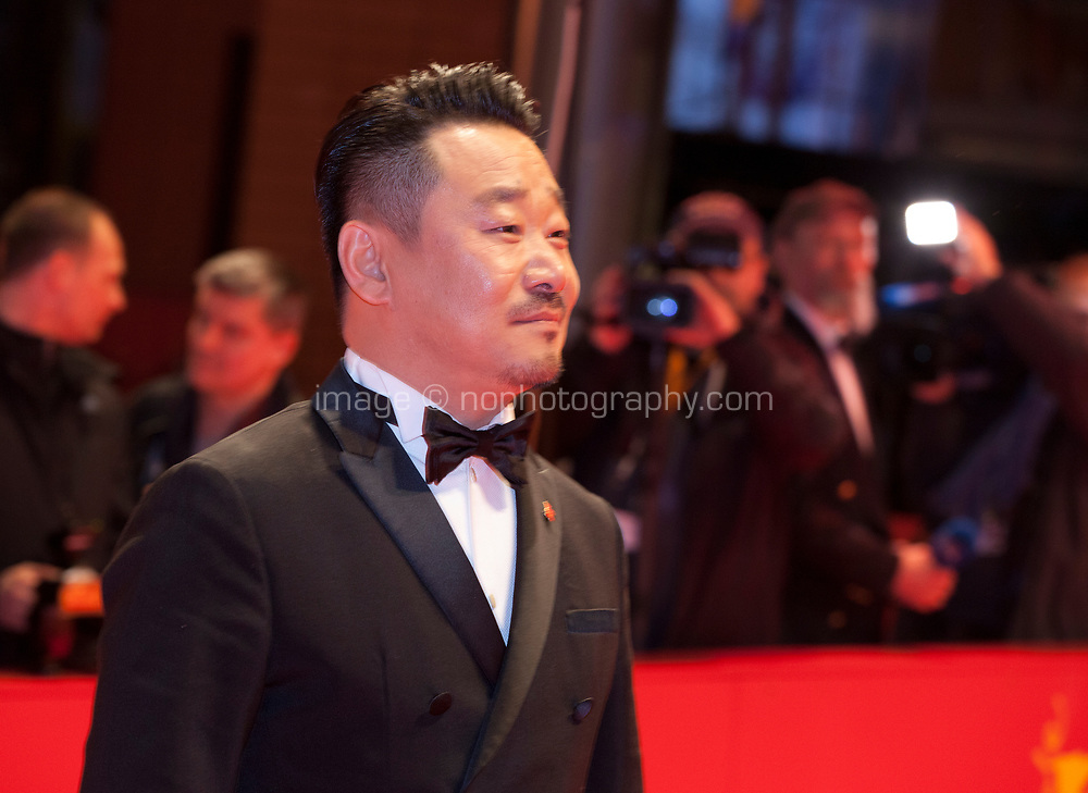 Actor Wang Jingchun, at the Award Ceremony red carpet at the 69th Berlinale International Film Festival, on Saturday 16th February 2019, Berlinale Palast, Berlin, Germany.