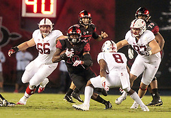 September 16, 2017 - San Diego, CA, USA - San Diego State running back Rashaad Penny, middle, carries the ball as Stanford safety Justin Reid (8) tries to stop him in the first quarter at Jack Murphy Stadium in San Diego on Saturday, Sept. 16, 2017. (Credit Image: © Hayne Palmour Iv/TNS via ZUMA Wire)