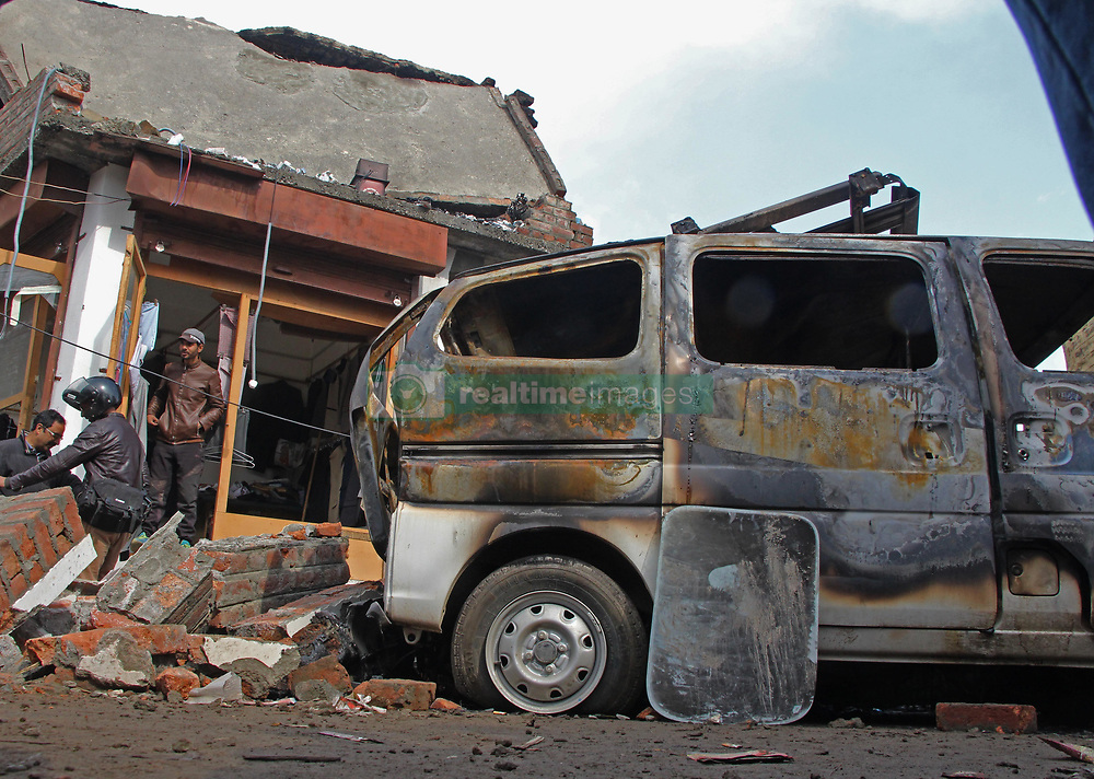 March 28, 2019 - Srinagar, India - A damaged vehicle is seen near the site of blast in Srinagar,Kashmir on March 28, 2019.Reports said a 'mysterious' blast occured near an India military camp in Aluchibagh area in Srinagar which has damaged public property and a civilian has sustained injuries.Police has reached the spot and is investigating the matter. (Credit Image: © Faisal Khan/NurPhoto via ZUMA Press)