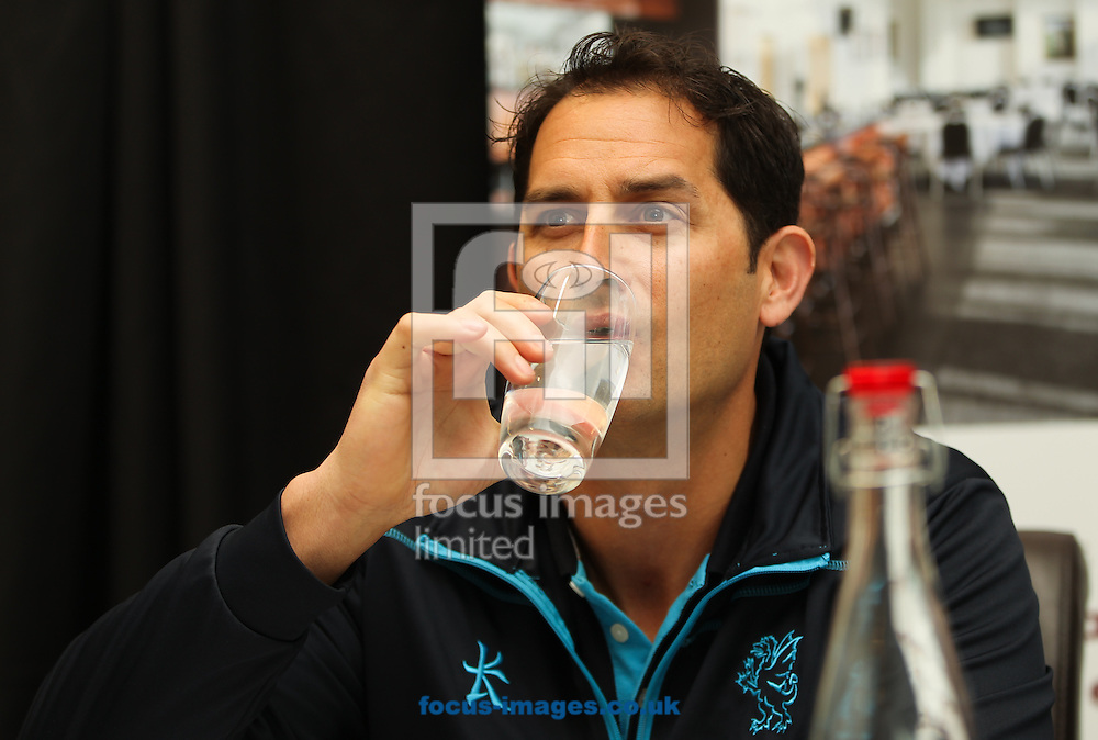 Somerset's assistant and bowling coach Jason Kerr takes a break from talking to drink a glass of water during a press conference held during the Somerset County Cricket Club media day at the County Ground, Taunton, Taunton<br /> Picture by Tom Smith/Focus Images Ltd 07545141164<br /> 31/03/2014