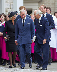 LONDON - UK - 11- SEPT - 2013: Britain's Prince Charles, The Prince of Wales,accompanied by Camilla, The Duchess of Cornwall and his sons Prince WIlliam and Prince Harry attend the funeral of Charles's close friend Hugh Van Cutsem at Brentwood Cathedral in Essex.<br /> Photo by Ian Jones