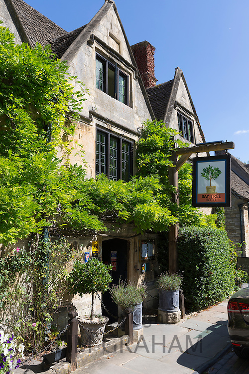 Pub sign of the Bay Tree Hotel a traditional old gastro pub hotel in Burford, The Cotswolds, Oxfordshire, UK