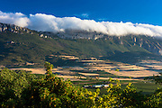 Weather front low cloud over mountains at Laguardia in Rioja-Alavesa wine-producing area, Spain