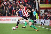 Brentford attacker, Sergi Canos (47) battling for ball with Bristol City defender, Adam Matthews (26) during the Sky Bet Championship match between Brentford and Bristol City at Griffin Park, London, England on 16 April 2016. Photo by Matthew Redman.