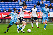 Bolton Wanderers midfielder Callum King-Harmesv tackled by Coventry City defender Brandon Mason during the EFL Sky Bet League 1 match between Bolton Wanderers and Coventry City at the University of  Bolton Stadium, Bolton, England on 10 August 2019.