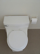 modern water saving toilet with toilet paper
