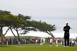 Feb 10, 2012; Pebble Beach CA, USA; Tiger Woods stands on the greens of the seventh hole during the second round of the AT&T Pebble Beach Pro-Am at Monterey Peninsula Country Club. Mandatory Credit: Jason O. Watson-US PRESSWIRE