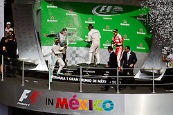 Formel 1: GP von Mexiko 2016 - Rennen in Mexiko-Stadt / 301016<br /> <br /> ***The podium (L to R): Nico Rosberg (GER) Mercedes AMG F1, second; Lewis Hamilton (GBR) Mercedes AMG F1, race winner; Sebastian Vettel (GER) Ferrari, third.<br /> 30.10.2016. Formula 1 World Championship, Rd 19, Mexican Grand Prix, Mexico City, Mexico, Race Day.<br />  Copyright: Price / XPB Images / action press ***