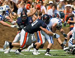 Virginia defensive end Chris Long (91) tackles Duke quarterback Zack Asack (13).  The Virginia Cavaliers defeated the Duke Blue Devils 23-14 at Scott Stadium in Charlottesville, VA on September 8, 2007  With the loss, Duke extended their longest-in-the-nation losing streak to 22 games.