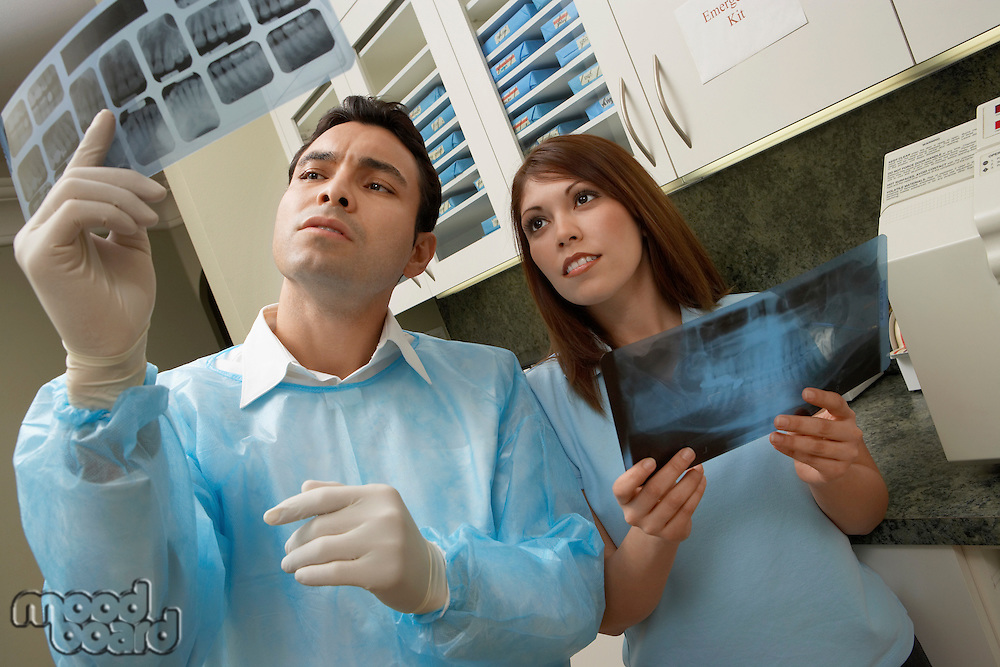 Dentist and Hygienist Examining X-rays