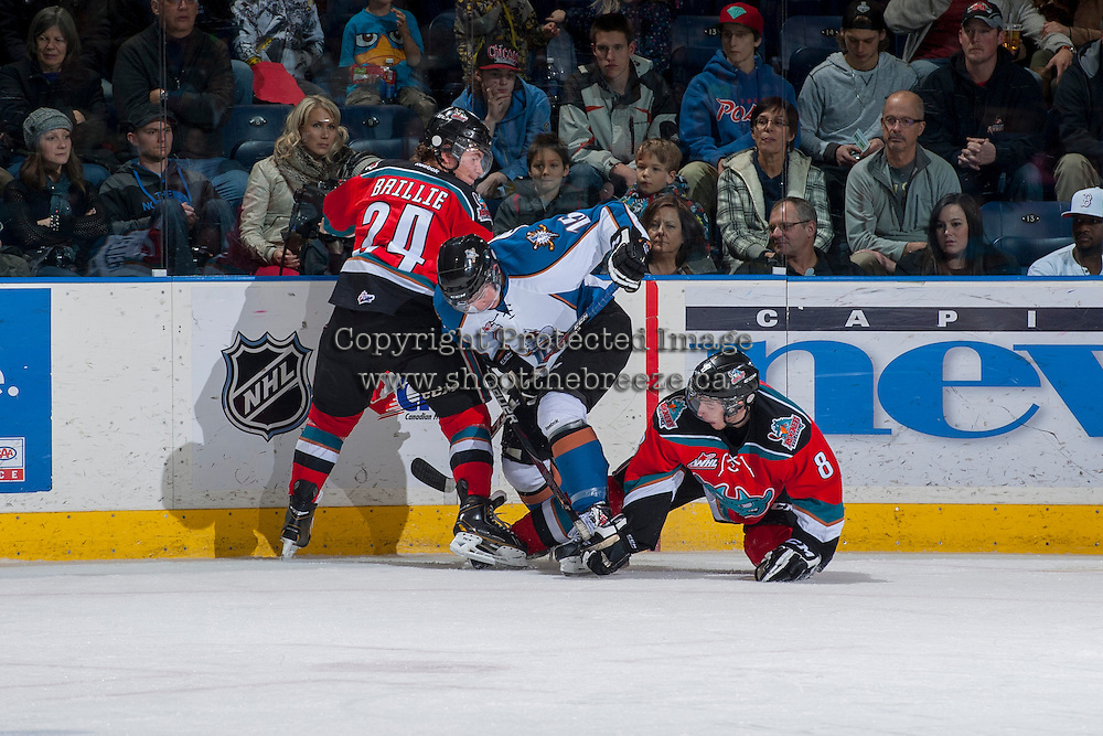 KELOWNA, CANADA - DECEMBER 7: Tyson Baillie #24 and Colten Martin #8 of the Kelowna Rockets check Austin Vetterl #15 of the Kootenay Ice at the boards on December 7, 2013 at Prospera Place in Kelowna, British Columbia, Canada.   (Photo by Marissa Baecker/Shoot the Breeze)  ***  Local Caption  ***