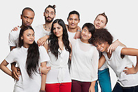 Portrait of young multi-ethnic friends posing against white background