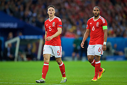 LILLE, FRANCE - Friday, July 1, 2016: Wales' James Chester and captain Ashley Williams in action against Belgium during the UEFA Euro 2016 Championship Quarter-Final match at the Stade Pierre Mauroy. (Pic by David Rawcliffe/Propaganda)