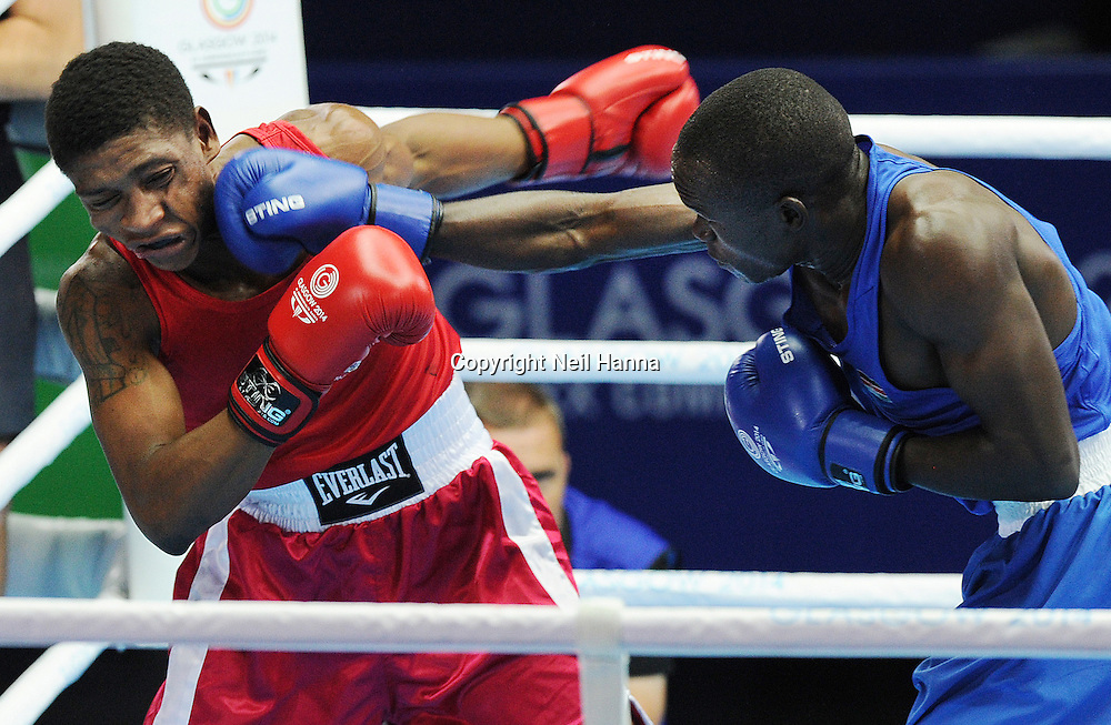 Commonwealth Games, Glasgow 2014<br /> SECC Boxing<br /> Preliminaries-Session 3<br /> Bout 38<br /> Men's Light Welter (60kg)<br /> John Colin of MRI (red) and Nicholas Okongo Okoth<br /> <br />  Neil Hanna Photography<br /> www.neilhannaphotography.co.uk<br /> 07702 246823