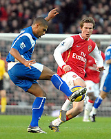 Photo: Ed Godden.<br />Arsenal v Portsmouth. The Barclays Premiership. 16/12/2006. Arsenal's Alexander Hleb (R), challenges Glen Johnson.