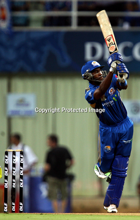Mumbai Indians Batsman Dwayne Bravo Hit The Shot Against Deccan Chargers During The Deccan Chargers vs Mumbai Indians, 25th Twenty20 match Indian Premier League- 2009/10 season Played at Dr DY Patil Sports Academy, Mumbai 28 March 2010 - day/night (20-over match)