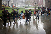 Schoolchildren enjoy dashing through a London street during a brief but intense rain shower.