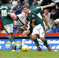 Photo: Dave Linney.<br />Derby County v Plymouth Argyle. Coca Cola Championship. 25/02/2006.Plymouth's  David Norris(R) fends off the challenge from  Alan Wright