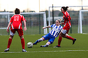 Brighton's Vicky Ashton-Jones makes a clearance during the FA Women's Premier League match between Brighton Ladies and Cardiff City Ladies at Brighton's Training Ground, Lancing, United Kingdom on 22 March 2015. Photo by Geoff Penn.