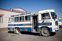 A bus waits for departurer at a bus terminal in Aralsk, Kazakhstan.