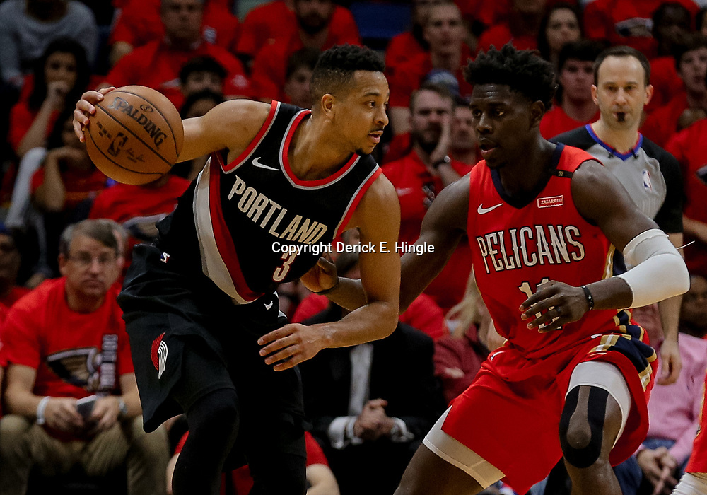 Apr 21, 2018; New Orleans, LA, USA; Portland Trail Blazers guard CJ McCollum (3) works against New Orleans Pelicans guard Jrue Holiday (11) during the second quarter in game four of the first round of the 2018 NBA Playoffs at the Smoothie King Center. Mandatory Credit: Derick E. Hingle-USA TODAY Sports