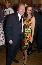 ANDREW ROBERTS and SUSAN GILCHRIST at a party to celebrate the publication of 'A Much Married Man' by Nicholas Coleridge held at the ESU, Dartmouth House,  37 Charles Street, London W1 on 4th May 2006.<br /><br />NON EXCLUSIVE - WORLD RIGHTS