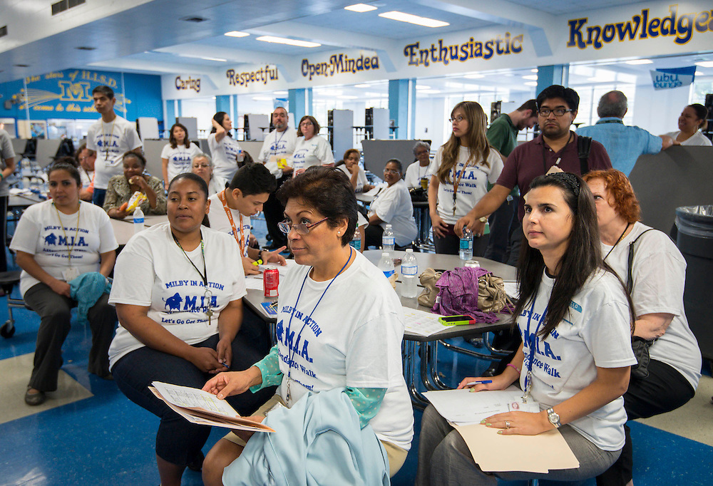 "Teachers and administrators prepare to go out the ""Milby in Action"" home visit initiative to reach students with excessive absences or failing grades at Milby High School, October 14, 2013."