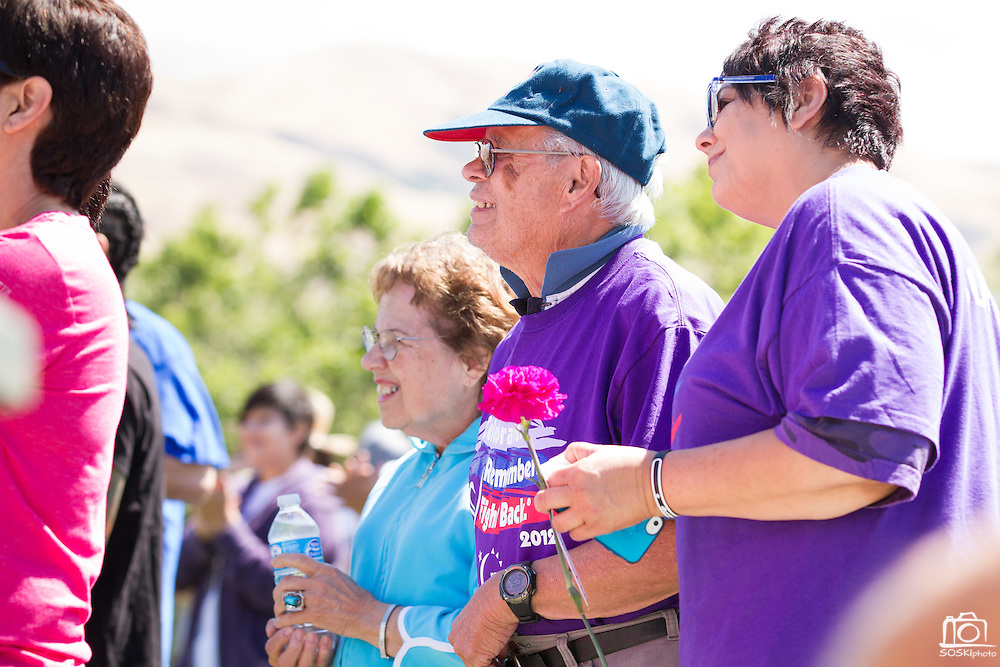 Charrisse Pommier (left) and Al Pascual interlock arms during the kick off of Relay For Life at the Milpitas Sports Center on June 23, 2012.  Pommier survived thyroid cancer and Pascual survived abdominal and rectal cancer.  Photo by Stan Olszewski/SOSKIphoto.