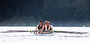 Members of the Canadian Olympic mens rowing four (left to right) Kai Langerfeld, Conlin McCabe, Tim Schrijver and Will Crothers row during a morning training session on Elk Lake in Victoria, British Columbia on June 22, 2016.