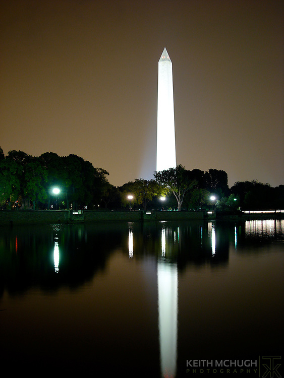 The Washington Monument reflecting upon the bay.