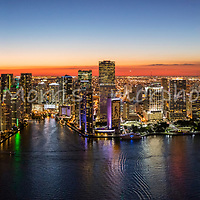 Panoramic aerial wide view of downtown Miami at twilight looking west from Biscayne Bay up the Miami River and featuring Bayfront Park and Brickell Key