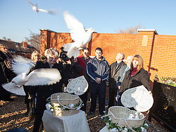 © Licensed to London News Pictures . 13/12/2012 . Hyde, Greater Manchester , UK . L-R June Bone (Fiona Bone's mother) and Sue Hughes (Nicola Hughes' mother) release doves . A memorial garden dedicated to PCs Fiona Bone and Nicola Hughes is opened at Hyde Police Station . The two officers were killed when responding to a routine call , earlier this year . Photo credit : Joel Goodman/LNP
