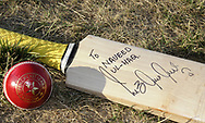 The cricket ball is 5.5 ounces, and hand crafted with a leather outer cover and cork on the inside.  This cricket bat was signed by Inzamam UL-Haq, the Pakistan cricket captain for the 2007 World Cup.