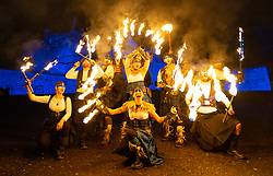 Edinburgh, Scotland, UK. 30th Dec 2019. Edinburgh's famous Hogmanay celebrations get under way with the Torchlight Procession along the historic Royal Mile in Edinburgh's Old Town and ending at Holyrood Park. The procession was led by the Celtic Fire Theatre company, PyroCeltica and the Harbinger Drum Crew. Pictured . Artists  perform on Edinburgh Castle Esplanade before the procession. Iain Masterton/Alamy Live News