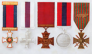 British Military decorations: left to right, Distinguished Service Order, Military Cross, Victoria Cross, Distinguished Conduct Medal. Right: French Croix de Guerre