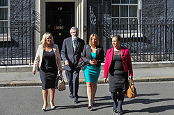 © Licensed to London News Pictures. 15/06/2017. London, UK. (L to R) Michelle O'Neill, leader of Sinn Féin, Gerry Adams, President, Mary Lou McDonald and Elisha McCallion exit Number 10.  Members of the Northern Ireland Assembly visit Downing Street for talks with Prime Minister Theresa May following the results of the General Election.  The Conservatives are seeking to work with the Democratic Unionist Party in order to form a minority government. Photo credit : Stephen Chung/LNP