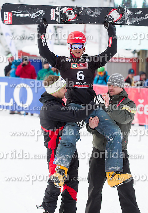 Second placed Zan Kosir of Slovenia celebrates after   the FIS Snowboard World Cup Rogla 2013 in Parallel Giant slalom, on February 8, 2013 in Rogla, Slovenia. (Photo By Vid Ponikvar / Sportida.com)