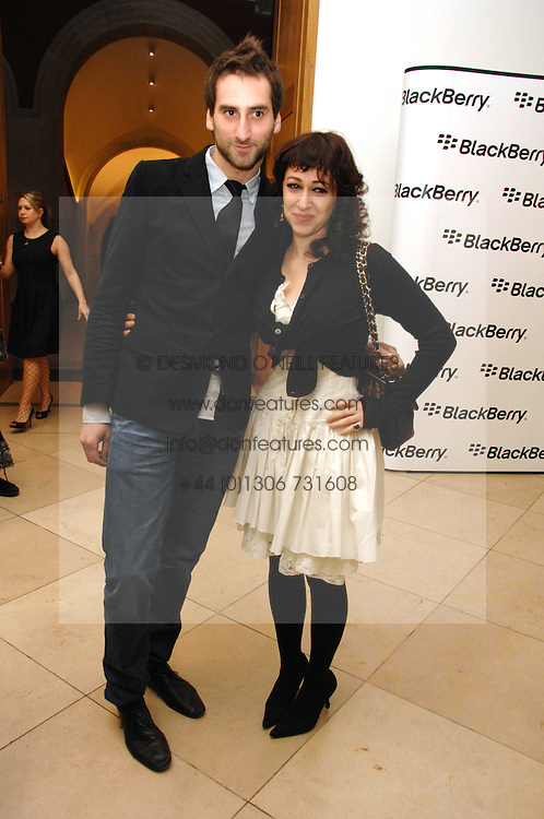 Artists IDRIS KHAN and ANNIE MORRIS at a private view of Bryan Adam's photographs entitled 'Modern Muses' held at The National Portrait Gallery, London on 11th March 2008.<br />