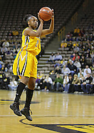 February 24 2011: Iowa Hawkeyes guard Kachine Alexander (21) puts up a shot during the first half of an NCAA women's college basketball game at Carver-Hawkeye Arena in Iowa City, Iowa on February 24, 2011. Iowa defeated Illinois 83-64.