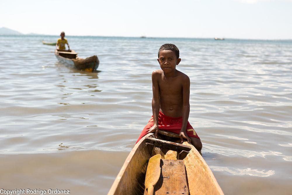 Yakob, 9 (foreground), and Rama, 10, sail fisherman boats in Lewoleba, Nubatukan subdistrict, Lembata district, East Nusa Tenggara province, Indonesia.